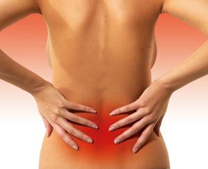 Почему болит низ спины